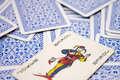 The joker on playing cards from a deck of other which are turned down Royalty Free Stock Image