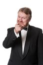 Joking middle aged man in tuxedo pointing happy wearing isolated on white Stock Image