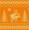 Joking orange knitted ornament with deers Stock Images