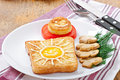 Jolly egg sandwich decorated with mushrooms and tomatoes Royalty Free Stock Images