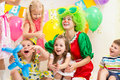 Jolly kids with clown on birthday party children Royalty Free Stock Photos