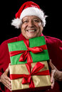 Jolly Male Pensioner In Red With Two Wrapped Gifts Royalty Free Stock Photo