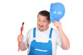 Jolly plumber with a pipe wrench Royalty Free Stock Photography