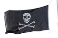 Jolly roger pirate flag a traditional Stock Images