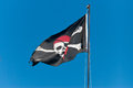 Jolly roger the pirate flag waving proudly Royalty Free Stock Photos