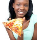 Jolly teen girl showing a slice of pizza Royalty Free Stock Photo