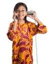 Jong meisje met tin can phone en smartphone i Stock Afbeelding