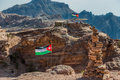 Jordan flags floating in nabatean city of petra middle east Stock Image