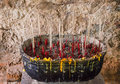 Joss sticks in an ashes pot in grunge background Royalty Free Stock Photo
