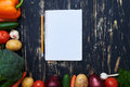 Jotter with a pencil surrounded with a collection of homegrown v Royalty Free Stock Photo