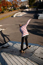 Joung boy jumps with his skateboard at the skate park fun Stock Images