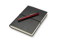 Journal and pen black or notebook closed with a red isolated on white with path Royalty Free Stock Photo