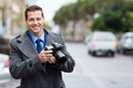 Journalist holding camera handsome a in the city in the rain Stock Photography