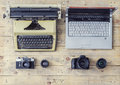 Journalistic equipment: typewriter, camera, laptop Royalty Free Stock Photo