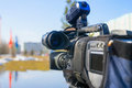 Journalistic television camera on city street. Royalty Free Stock Photo