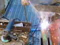 Journeyman welder with the torch and the torch while repair sheet Royalty Free Stock Photo