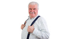 Jovial confident elderly man with a moustache and his hands hooked through his suspenders beaming happily at the camera upper body Royalty Free Stock Images