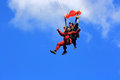 Joy of first parachute jump waterdown ontario canada august skydivers in tandem on the way to the earth on august in waterdown Royalty Free Stock Photo