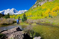 Joy at maroon bells a girl jumps in freedom and wonder the scenic aspen colorado in fall Royalty Free Stock Photo
