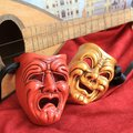 Joy and sadness carnival mask red gold plaster in red gold with mandolin in background Royalty Free Stock Photos
