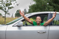 Joyful african american driver male arms out of car window Royalty Free Stock Photos