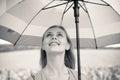 Joyful beautiful girl holding umbrella in sunflower field background Royalty Free Stock Photo