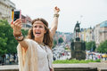 Joyful bohemian woman making selfie on Wenceslas Square, Prague Royalty Free Stock Photo
