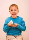 Joyful boy holding baby chick Royalty Free Stock Photography