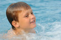Joyful boy in water young swimming a swimming pool Stock Photos
