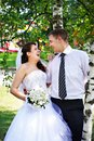 Joyful bride and groom near birches Stock Image