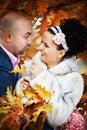 Joyful bride and groom in yellow autumn foliage Royalty Free Stock Photography