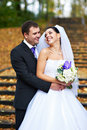 Joyful bride and groom in yellow autumn park Royalty Free Stock Photos