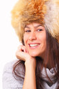 Joyful brunette woman in a fur hat Royalty Free Stock Photos