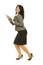 Joyful business woman pointing to left part Royalty Free Stock Photo