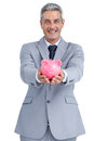 Joyful businessman holding piggy bank on white background Royalty Free Stock Photo
