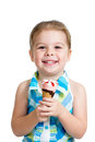 Joyful child girl eating ice cream in studio isolated Royalty Free Stock Photography