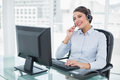 Joyful classy brown haired operator answering a call in bright office Royalty Free Stock Photo