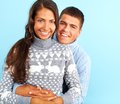 Joyful dates portrait of amorous couple in fashionable pullovers looking at camera with smiles Stock Photo