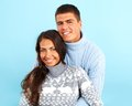 Joyful dates portrait of amorous couple in fashionable pullovers looking at camera with smiles Royalty Free Stock Photos