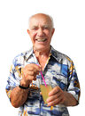 Joyful elderly man very holding a cocktail Stock Photos