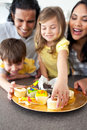Joyful family eating cookies Stock Images