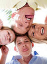 Joyful family making weird faces in huddle Royalty Free Stock Photo