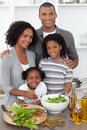 Joyful family preparing dinner Stock Image
