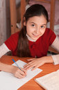 Joyful girl doing homework notebook Stock Photos