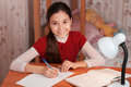 Joyful girl doing homework notebook Royalty Free Stock Images