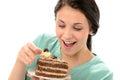 Joyful girl eating tasty piece of cake Royalty Free Stock Photo