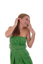 Joyful girl pretty is smiling in green dress Royalty Free Stock Image