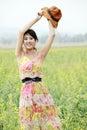 Joyful girl in rape field Stock Photo