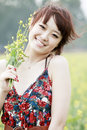 Joyful girl in rape field Royalty Free Stock Photo