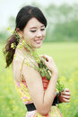 Joyful girl in rape field Royalty Free Stock Photos